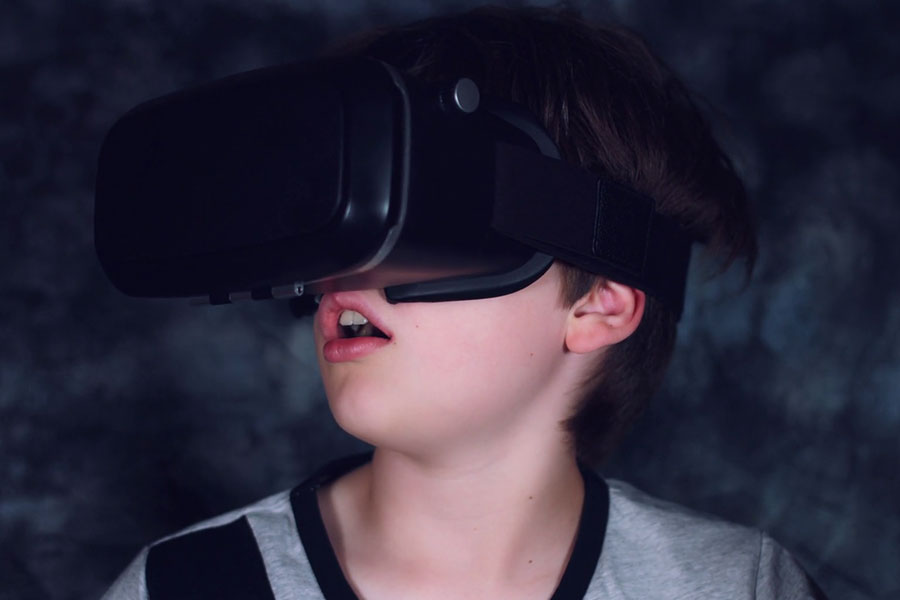 child with vr headset