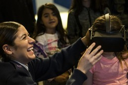 young girl wearing vr headset